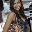 WomWith Purse At Clothes Shop — Stock Photo #21789889