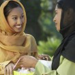 Two Young Muslim Women Talking Outdoors — Stok fotoğraf