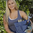 Young Woman Holding Gardening Toolkit - Stock Photo