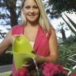 Young Woman Watering Plant — Stock Photo