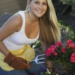 Beautiful Woman Gardening — Stock Photo #21789983