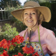 Senior Woman Holding Flower Plant — Stock Photo