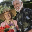 Senior Couple Standing Together In Garden — Stock Photo