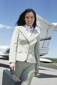 Happy Businesswoman Walking On Airfield — Stock Photo