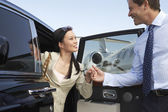 Happy Business Couple Getting Off A Car — Stock Photo