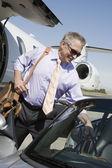 Senior Businessman Keeping Luggage In Car — Stock Photo