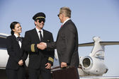 Senior Businessman Thanking Airplane Captain — Stock Photo