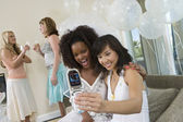 Friends Taking Self Portrait Through Cell Phone — Stock Photo