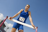 Female Athlete Standing At Hurdle — Stock Photo