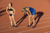 Tired Female Athletes On Racing Track — Stock Photo
