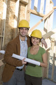 Couple With Blueprint At Site — Stock Photo