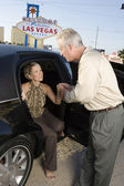 Woman Stepping Out Of Limousine Man Assisting — Stock Photo