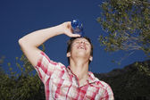 Teenage Boy Spilling Water On Face — Stock Photo