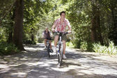 Teenage Boys Bicycling In Forest — Stock Photo