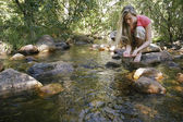 Woman At Forest Stream — Stock Photo
