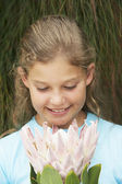 Girl Looking At Fresh Flower — Stock Photo