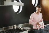 Man With Tea Towel In Kitchen — Stock Photo