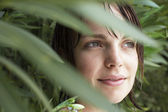 Woman Hiding In Foliage — Stock Photo