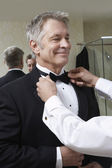 Man Adjusting Senior Man's Bow Tie — Stock Photo
