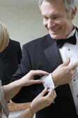 Woman Fastening Husband's Cufflink — Stock Photo