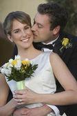 Groom Kissing Bride — Stock Photo