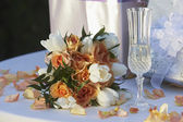 Bouquet With Champagne Flute and Gifts — Stock Photo