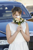 Bride Smelling Fragrance Of Flowers — Stock Photo