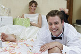 Newlywed Couple Relaxing In Bed — Stok fotoğraf