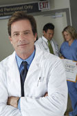 Doctor Standing Arms Crossed — Stock Photo
