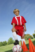 Boy With Foot On Soccer Ball — 图库照片