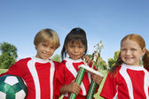 Children With Soccer Ball And Trophy — Stock Photo