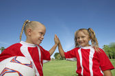 Girls Giving a High-Five On Soccer Field — Stock Photo