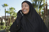 Muslim Woman In Black Hijab Using cell Phone — Stock Photo