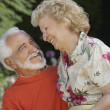 Senior Couple Embracing At Garden — Stock Photo #21790055