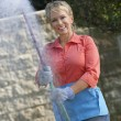 Woman Spraying Pesticides In Garden — Stock Photo