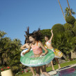 Cheerful Children Jumping Into Swimming Pool - Foto Stock