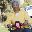 Senior Woman On Motor Scooter — Stock Photo