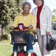 Senior Woman On Motor Scooter With Friend — Stock Photo #21791045