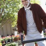 Senior Man With Walking Frame At Botanical Garden — Stock Photo #21791053