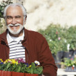Senior Man With Flowerpots — Stock Photo