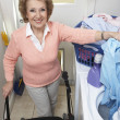 Senior Woman With Laundry By Washing Machine — Stock Photo