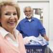 Royalty-Free Stock Photo: Senior Couple With Laundry In Bathroom