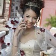 Quinceanera Using Cell Phone — Stockfoto