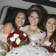 Stock Photo: Quinceanera Sitting With Friends In Limousine