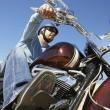 muž na koni motocyklu — Stock fotografie