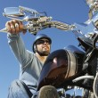 Stock Photo: Biker On Bike Biking