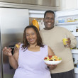 Couple With Food And Drink By Open Fridge — Stock Photo