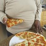 Man Holding Slice Of Pizza — Stock Photo