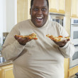 Man Holding Slices Of Pizza And Laughing — Stock Photo
