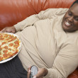 Man Watching TV With Pizza On Lap — 图库照片
